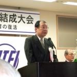 挨拶する長澤直臣東京都教育研究連盟会長