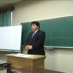 挨拶をする田中事務局長